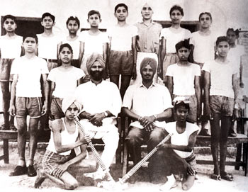 Extreme left in middle row: Om was part of the hockey team in Sanaur Government High School