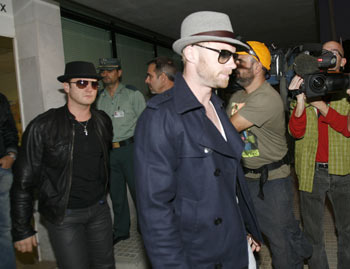 Boyzone members Mikey Graham (left) and Ronan Keating arrive at Son San Joan airport on Sunday