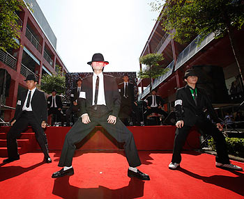Dancers impersonating Michael Jackson perform on the red carpet during the Taiwan premiere of This Is It in Taipei