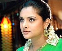 Ramya in a scene from Abhiyum Naanum