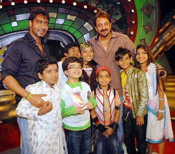 Ajay Devgan and Sanjay Dut pose with kids