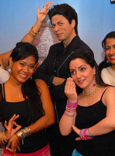 Bollywood Axion Dance Troupe perform in front of the wax figure of Shah Rukh Khan
