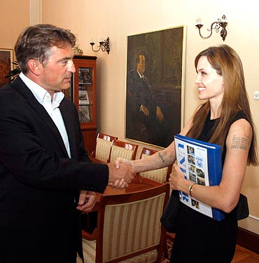 Angelina Jolie shakes hands with Zeljko Komsic, Croat member of Tripartite Bosnian Presidency