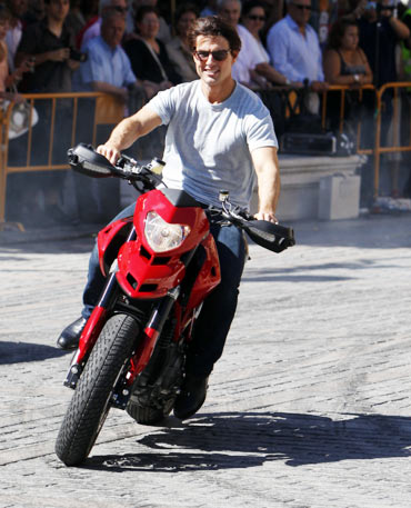 Tom Cruise rides his motorbike