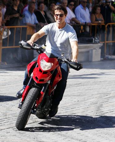 Tom Cruise rides his motorbike