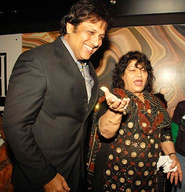 Govinda and choreographer Saroj Khan