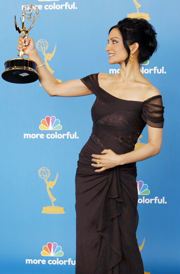 Archie Panjabi poses with her award for outstanding supporting actress in a drama series backstage at the 62nd annual Primetime Emmy Awards in Los Angeles