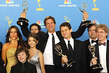 Executive producer Steven Levitan (C) of Modern Family poses with fellow producers and cast members after winning outstanding comedy series