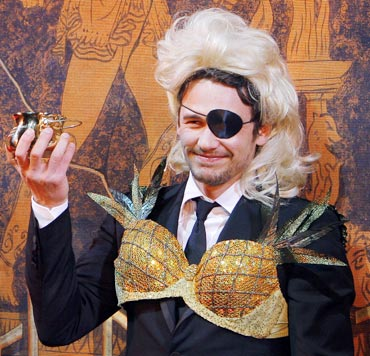 James Franco holds up his Pudding Pot award during ceremonies to honor him as Hasty Pudding Theatricals' 2009 Man of the Year at Harvard University in Cambridge, Massachusetts