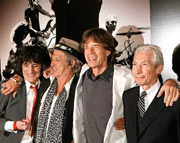 Rolling Stones band members Keith Richards (2nd L), Mick Jagger (2nd R), Ronnie Wood (L), and Charlie Watts