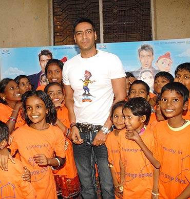 Ajay Devgn poses with school children
