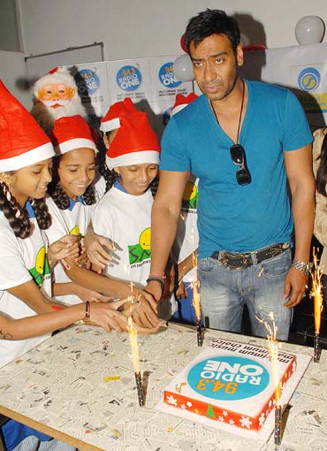 Ajay Devgn with children from Smile Foundation