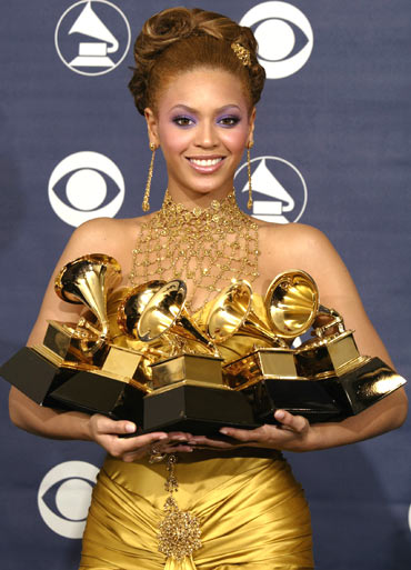 Beyonce holds the five Grammy awards she won at the 46th annual Grammy Awards