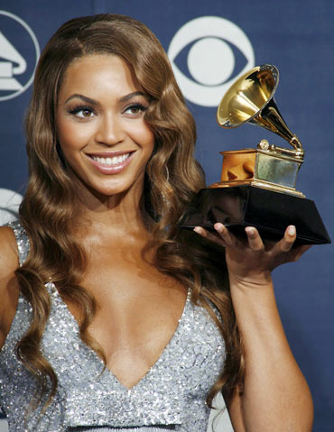 Beyonce holds the Grammy for Best Contemporary R and B Album at the 49th Annual Grammy Awards