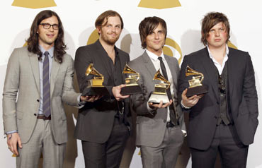 Kings of Leon members (from left) Caleb Followill, Jared Followill, Matthew Followill and Nathan Followill hold their awards backstage