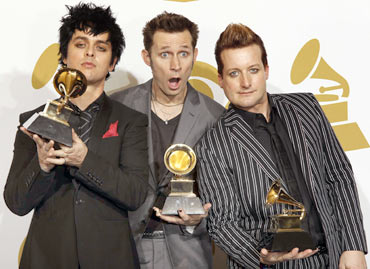 Green Day's Billie Joe Armstrong, Mike Dirnt and Tre Cool pose backstage with their award