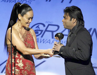 A R Rahman accepts the award for best compilation soundtrack album from Tia Carrere