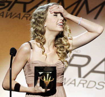 Taylor Swift reacts as she accepts the award for best female country vocal performance