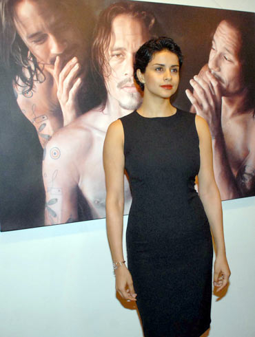 Gul Panag poses in front of Heath Ledger's portrait by Vincient Fantauzzo