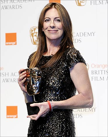 Kathryn Bigelow poses with her award for Best Director.