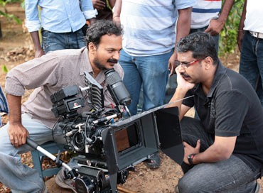 Cinematographer Nirav Shah and director C S Amudhan discuss a scene