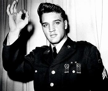 Elvis Presley is pictured in his United States Army uniform in this undated publicity photograph