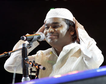 A R Rahman puts on a cap during his performance
