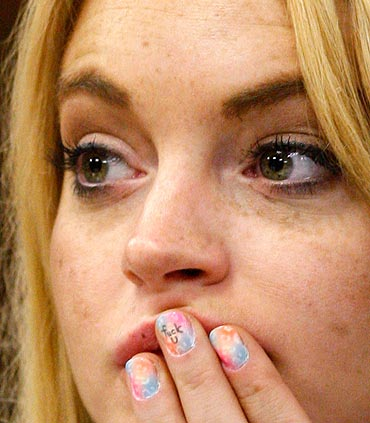Lindsay Lohan looks on in court before Judge Marsha Revel ruled that Lohan had violated her probation on a 2007 drunken driving charge