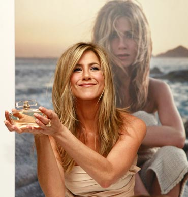 Jennifer Aniston poses with her fragrance 'Jennifer Aniston' during its launch at Harrods in London.