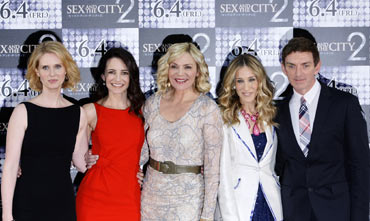 Cynthia Nixon, Kristin Davis, Kim Catrall and Sarah Jessica Parker and Director Michael Patrick King in Tokyo on Monday