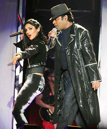 A R Rahman and a singer perform
