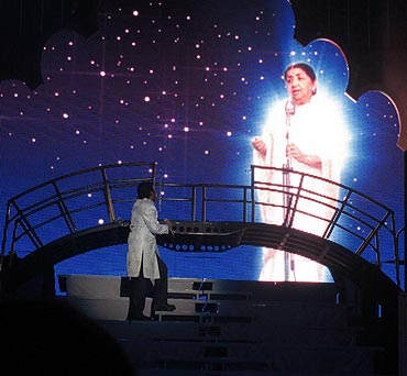 A R Rahman gazes at an image of Lata Mangeshkar