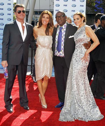 Simon Cowell, his girlfriend Mezhgan Hussainy, Randy Jackson and Kara DioGuardi