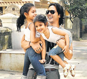 Arjun Rampal with Mahikaa and Myra