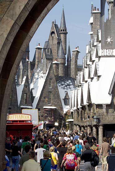Guests enter The Wizarding World of Harry Potter theme park