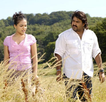 Nithya Menon and Mohanlal in a scene from Akashagopuram