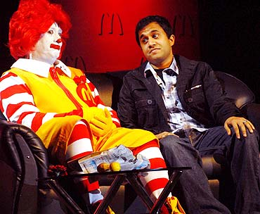 A man dressed as Ronald McDonald -- McDonald's mascot -- poses with actor Omi Vaidya.