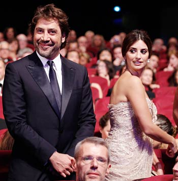 Javier Bardem arrives with his partner actress Penelope Cruz at the award ceremony