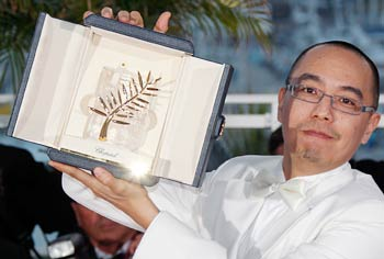 Apichatpong Weerasethakul attends a photocall after winning the Palme d'Or award