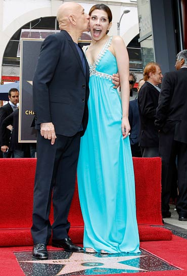 Sir Ben Kingsley kisses his wife Daniela Lavender
