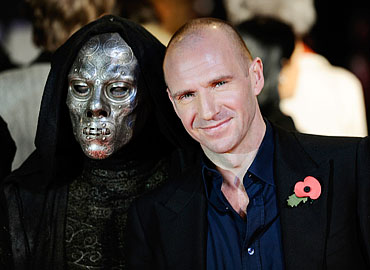 Ralph Fiennes poses with the mask of evil