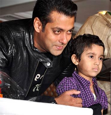 Salman Khan hugs a child