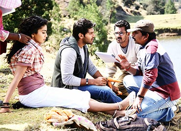 Manigandan (in a cap) directs Arya and Shriya