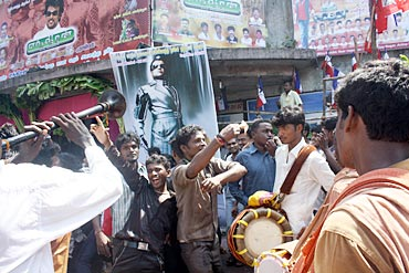 Fans dance to traditional South Indian music