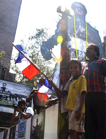 A 61 feet poster of Rajnikanth erected at the theatre