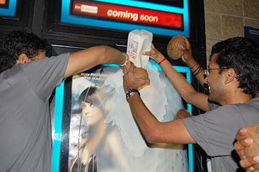 A poster of Endhiran is doused with milk
