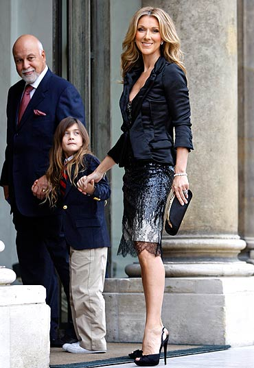 Celine Dion arrives with her husband Rene Angelil and son Rene-Charles