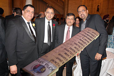 Rajeev Bambari, Atul Kumria, Prabhu Dayal and Kapil Kumria pose with the signed cricket bat.
