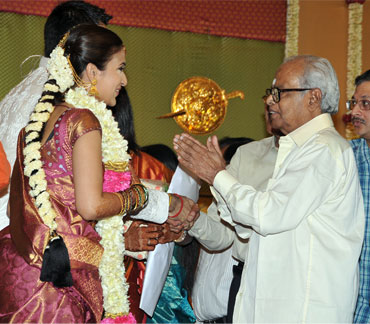 The couple greets K Balachander
