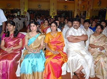 Prabhu sits among the guests